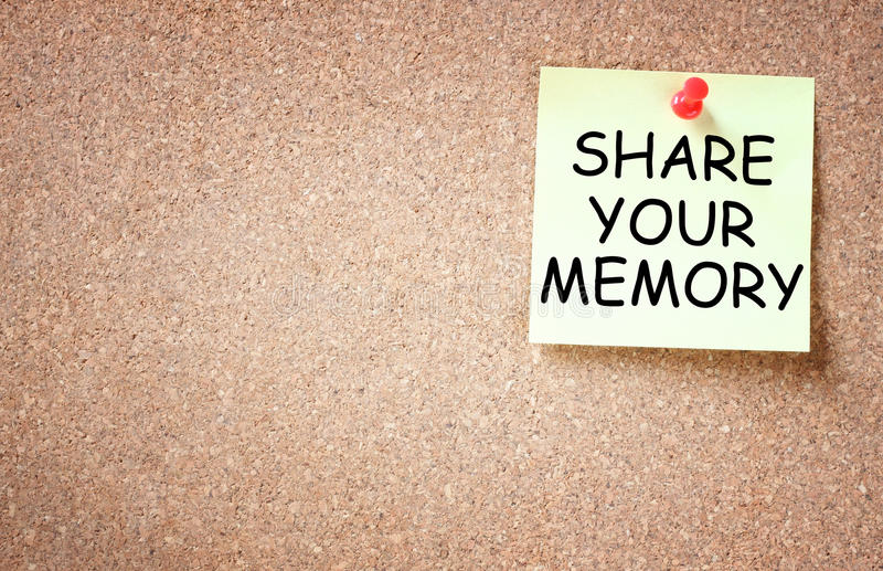 Sticky pinned to cork board with the phrase share your memory stock image