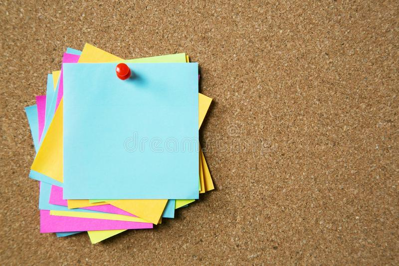 Sticky post it note paper reminder schedule board. Colorful variety copy empty space. soft focus. Close up hand people business man notes pad in the wall at royalty free stock photo