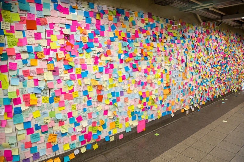 Sticky post-it notes in NYC subway station stock images
