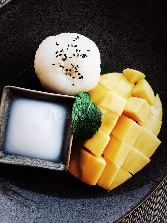 Sticky rice and mango with coconut milk stock photo