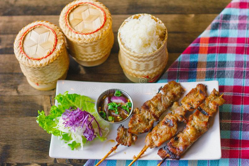 Sticky rice with pork skewer royalty free stock image