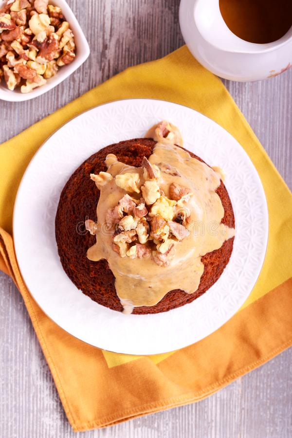 Sticky toffee pudding with caramel sauce. And nuts royalty free stock photos