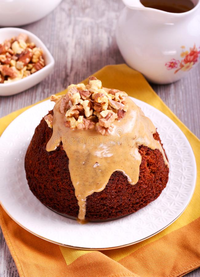 Sticky toffee pudding with caramel sauce. And nuts royalty free stock photography