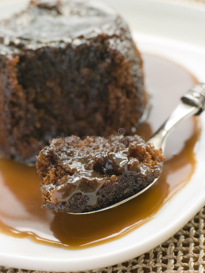 Sticky Toffee Pudding with Toffee Sauce stock photo