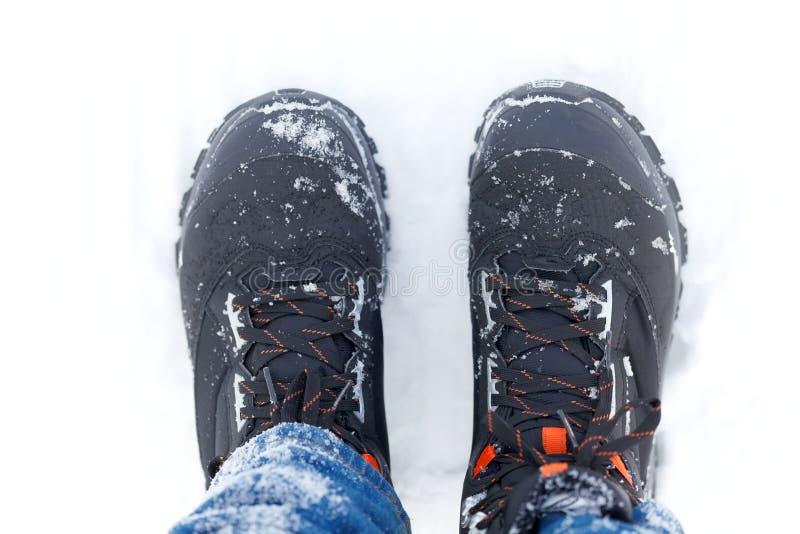 Stiefel im Schnee lizenzfreie stockfotografie