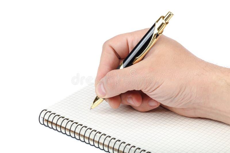 Stift in der Hand und Notizbuch auf weißem Hintergrund lizenzfreie stockbilder