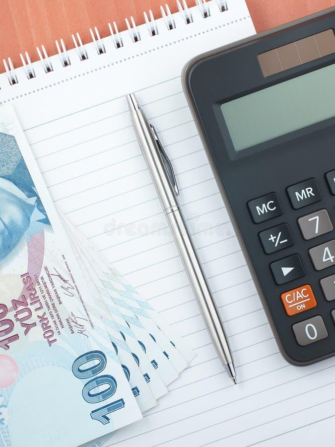 Stiftnotizblock-Taschenrechnerlira stockfoto
