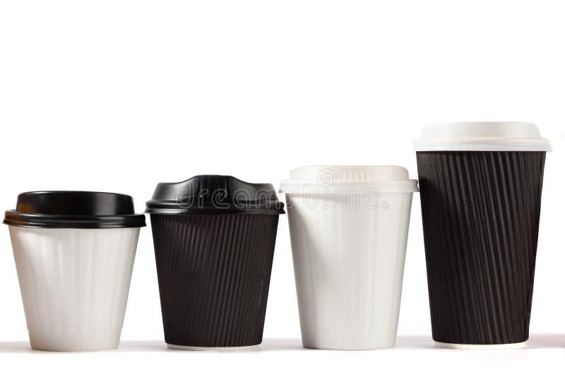 Stigande höjd för fyra disponibel kaffekoppar fotografering för bildbyråer
