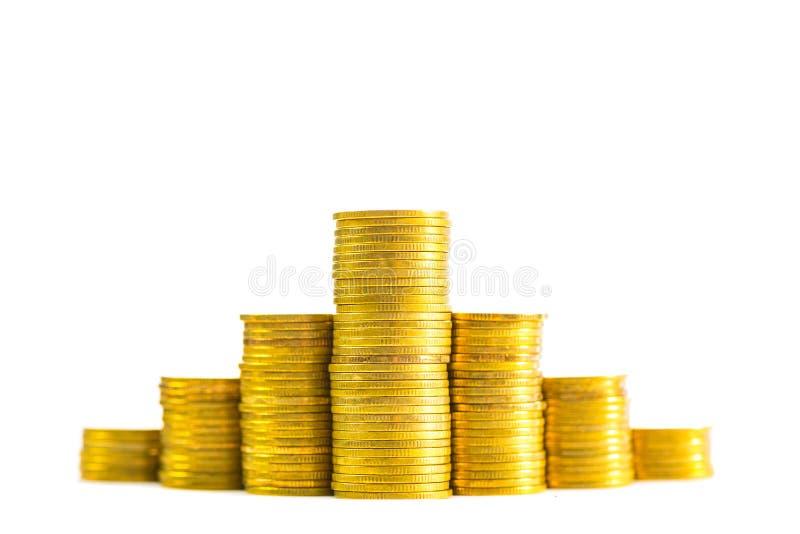 Stijgende kolommen van muntstukken, stapels van gouden die muntstukken als g worden geschikt stock afbeelding