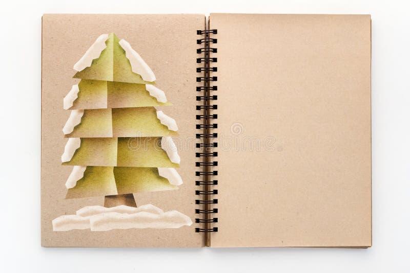 Stil för snitt för X'mas trädpapper på sketchbook för tom sida arkivbild