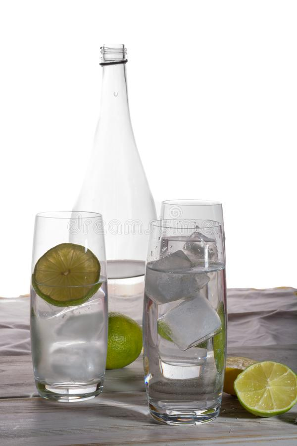Stil mineral drink water in glass bottle served with three glass royalty free stock photo