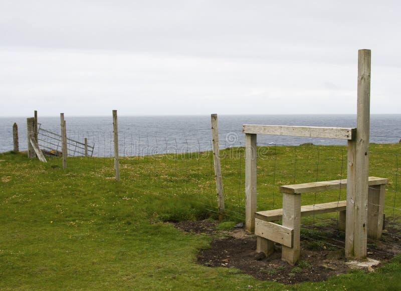 Stile. On open grassland by the sea, Shetland, Scotland royalty free stock photo