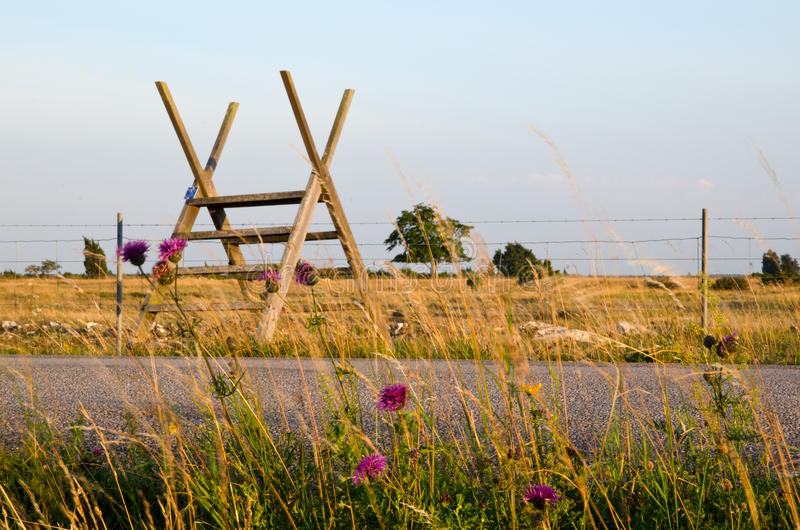 Stile at barb wire