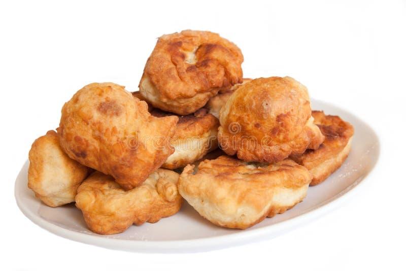 Stile bulgaro fritto dei dolci isolato - mekici immagini stock libere da diritti