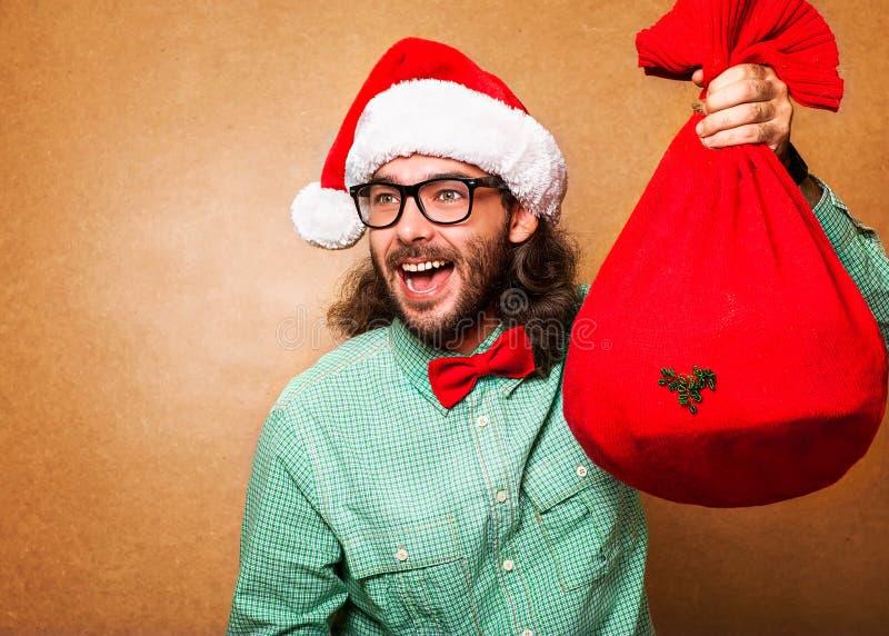 Stile dei pantaloni a vita bassa. Santa Claus con la borsa dei presente fotografie stock libere da diritti