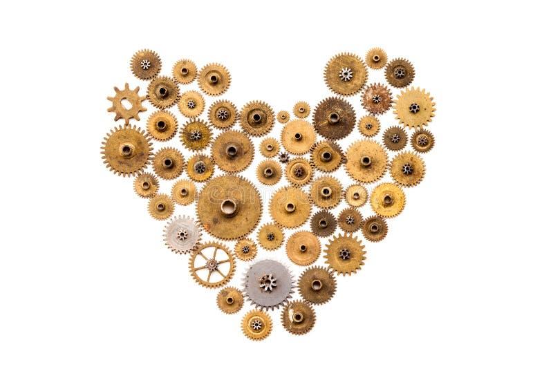Stile dell'ornamento dello steampunk del cuore su fondo bianco Il movimento a orologeria d'annata parte il primo piano Forma mecc fotografia stock