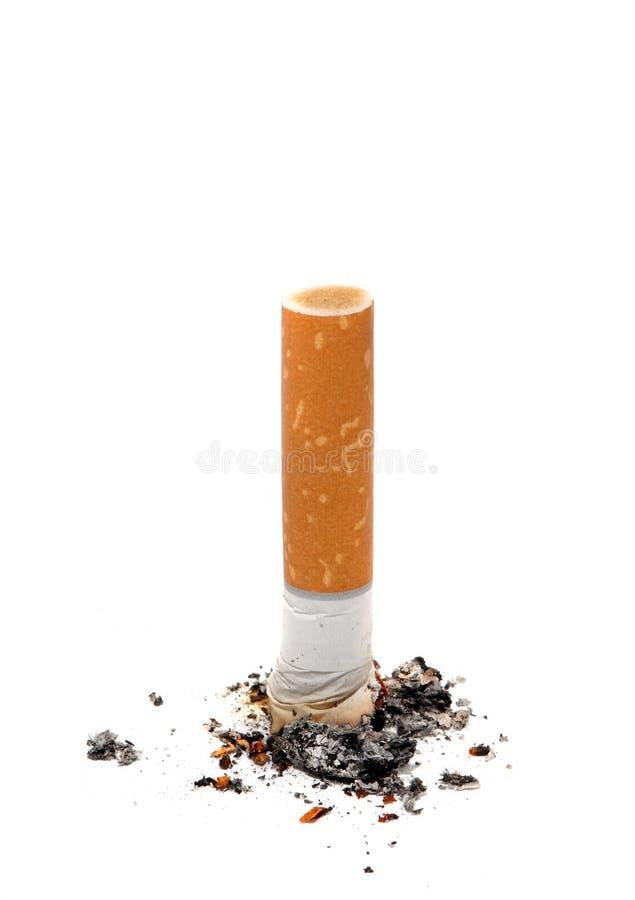 Stile di vita non sano di estremità di sigaretta fotografia stock