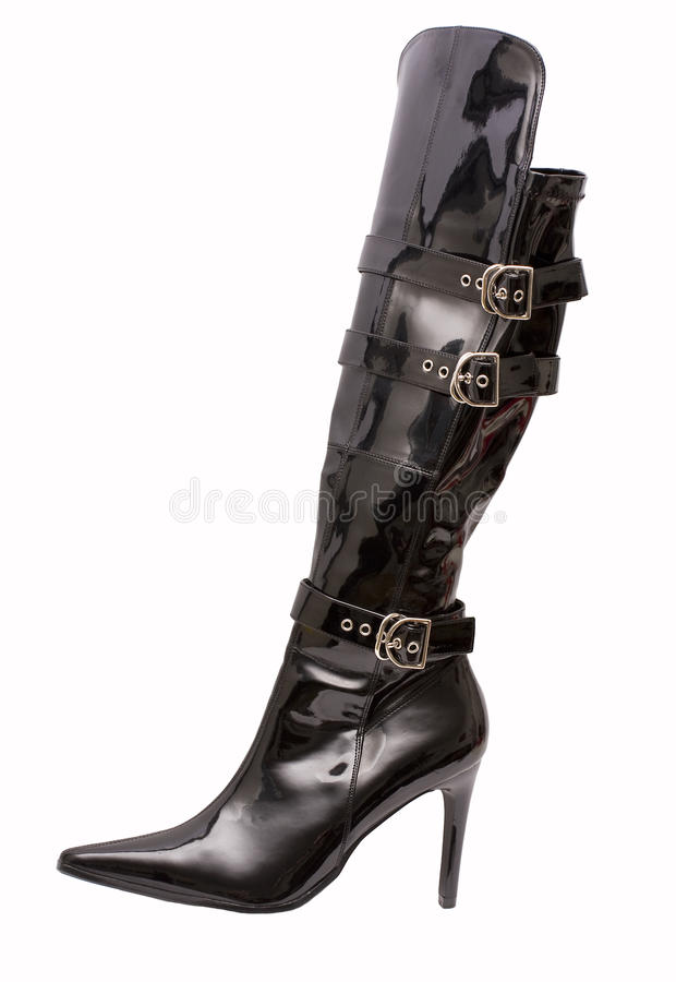 Stiletto Boot. A black patent leather stiletto boot isolated on a white background stock photos