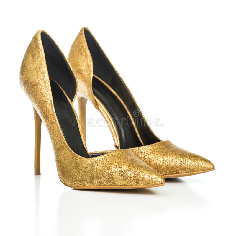 Stiletto high heels shoes in golden animal print design. Classic stiletto high heels shoes in golden snake-print design. PLEASE NOTE: this is a no-name product royalty free stock image