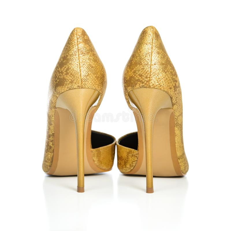 Stiletto high heels shoes in golden animal print design. Classic stiletto high heels shoes in golden snake-print design. PLEASE NOTE: this is a no-name product stock photos