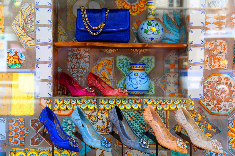 Stilettos purse. Stilettos and a blue purse displayed with colorful tile and vases