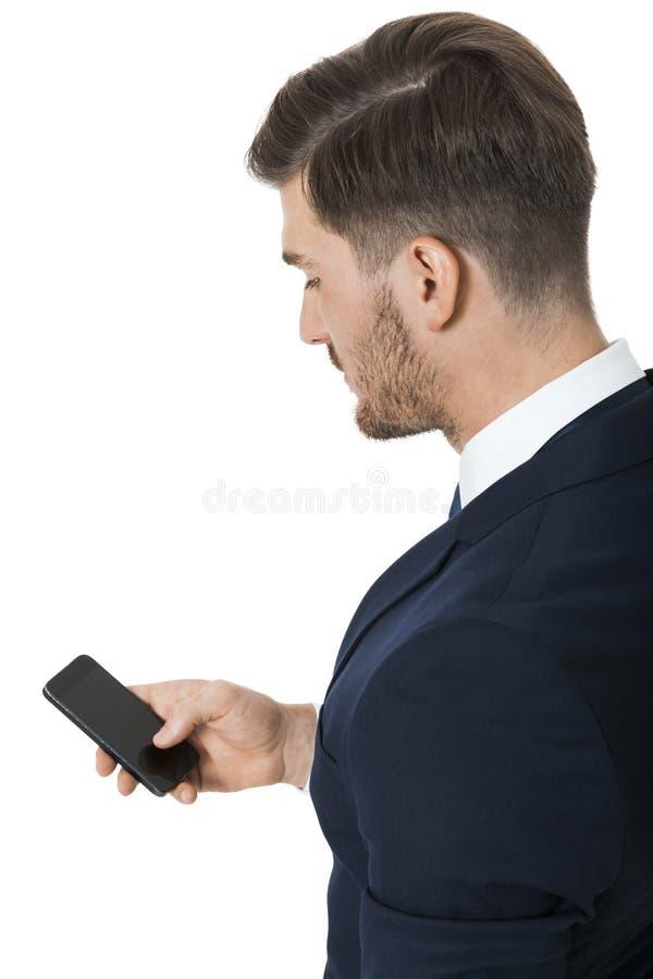 Stilfull affärsman som pratar på hans mobil arkivfoton