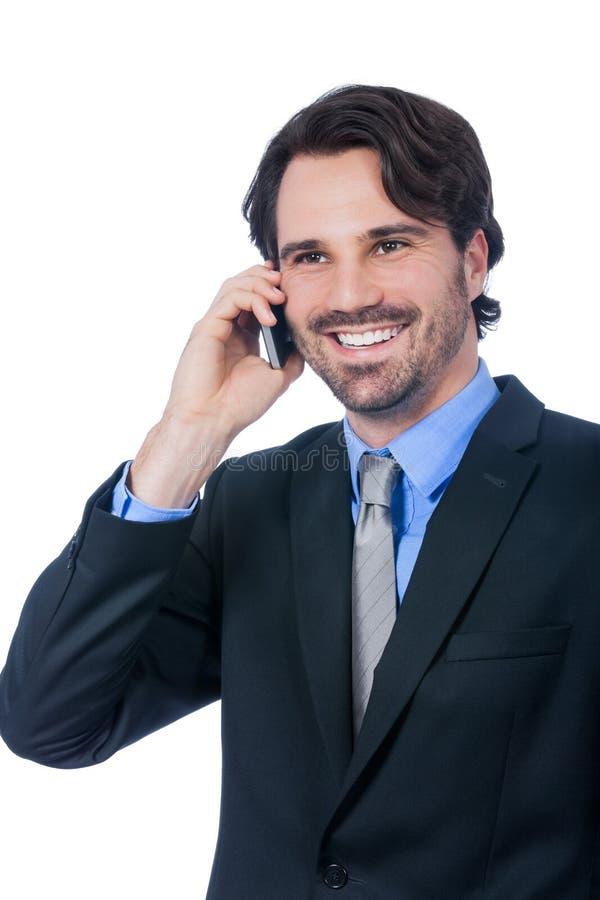 Stilfull affärsman som talar på hans mobiltelefon royaltyfria foton