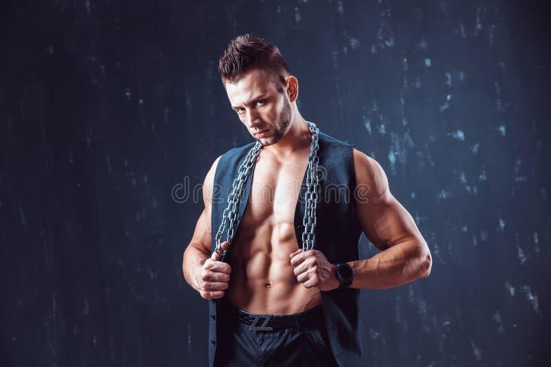 Stilfull shirtless man i waistcoat royaltyfria bilder
