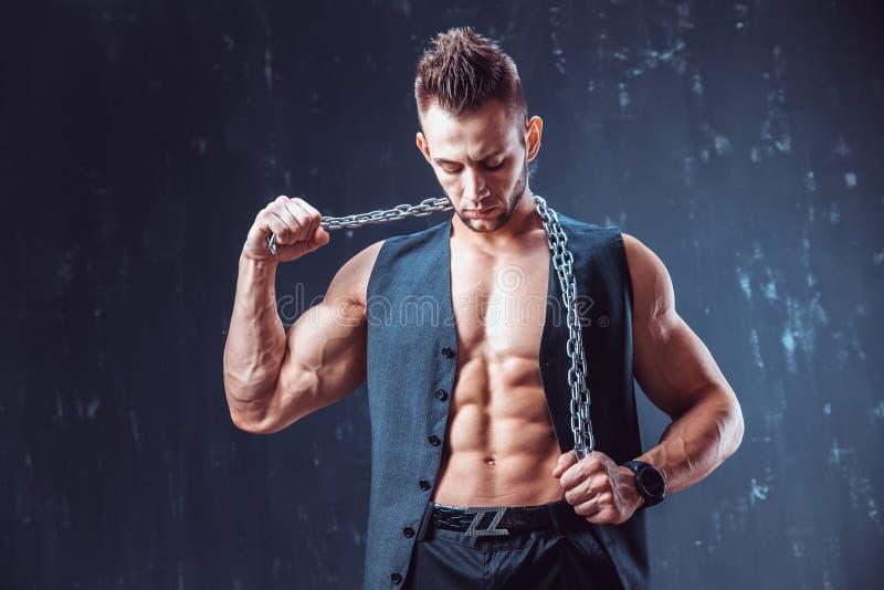 Stilfull shirtless man i waistcoat royaltyfria foton