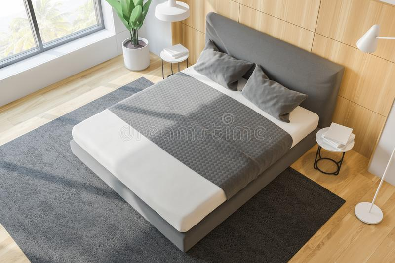 Stilfull sovruminre med vit sängkläder av konungformatsäng i innegrej 3d framför Top beskådar royaltyfri illustrationer