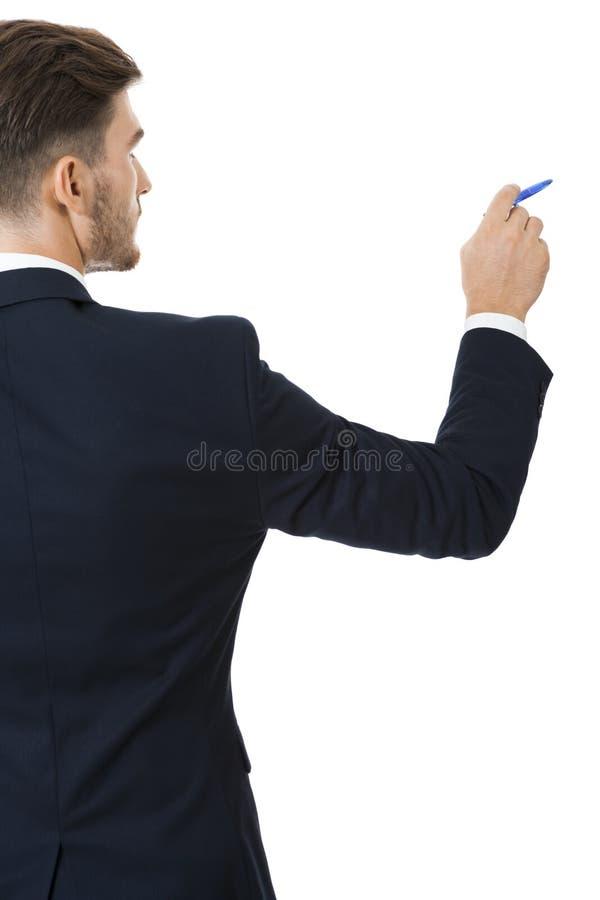 Stilfull ung affärsman som gör en presentation royaltyfri bild