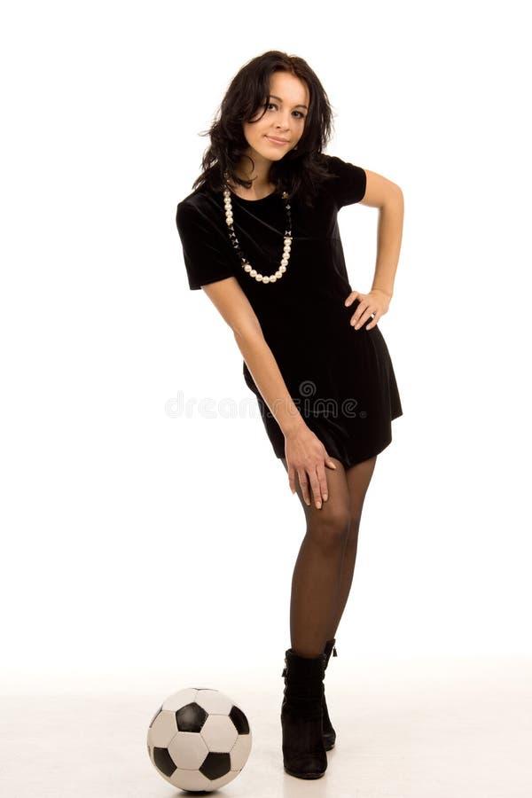 Stilfull ung kvinna i en miniskirt royaltyfri fotografi