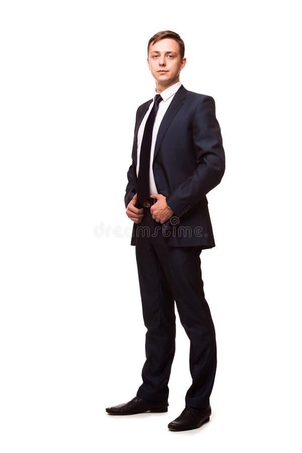 Stilfull ung man i dräkt och band kvinna för white för affärspennstil Stiligt mananseende och se kameran royaltyfri foto