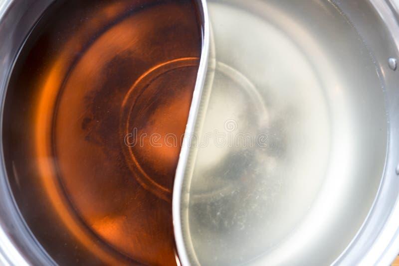 Stili cinesi del hotpot due dell'alimento della minestra di shabu fotografia stock libera da diritti
