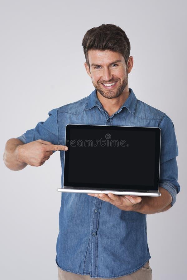stilig bärbar datorman fotografering för bildbyråer