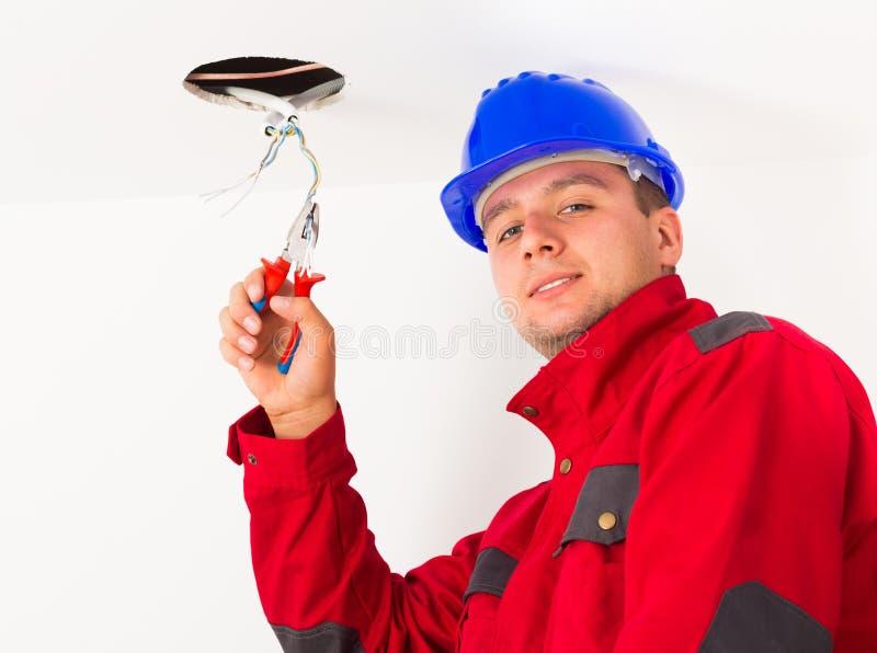 Stilig elektriker Working royaltyfria bilder