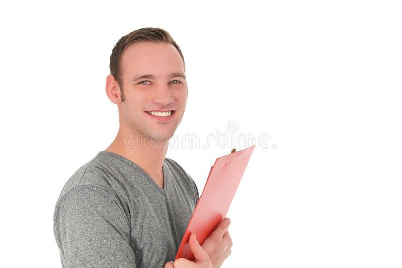 Stilig le man som rymmer en skrivplatta arkivbild