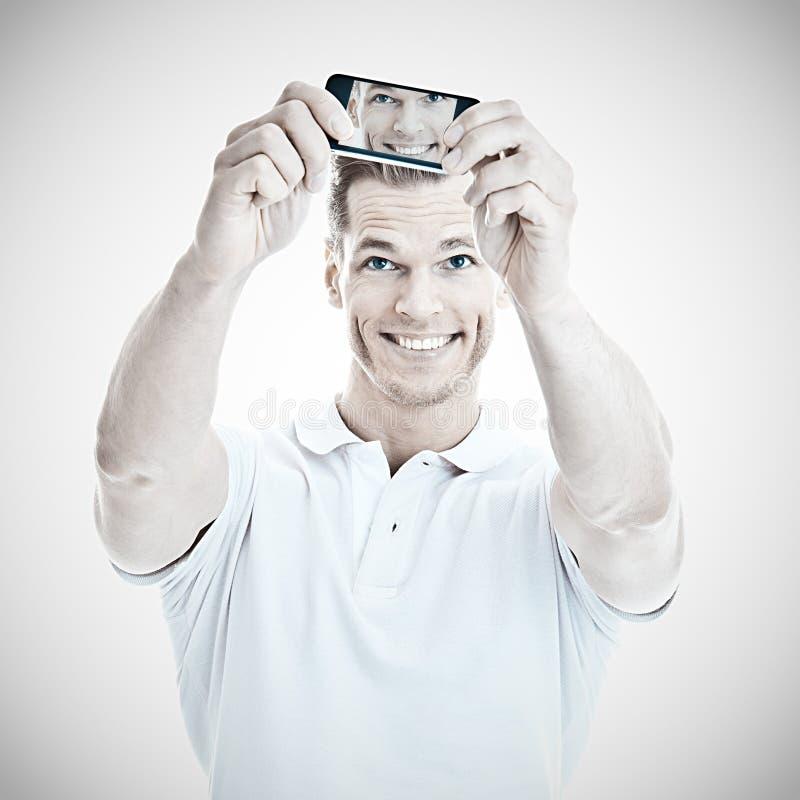 Stilig man som tar en selfie royaltyfria foton