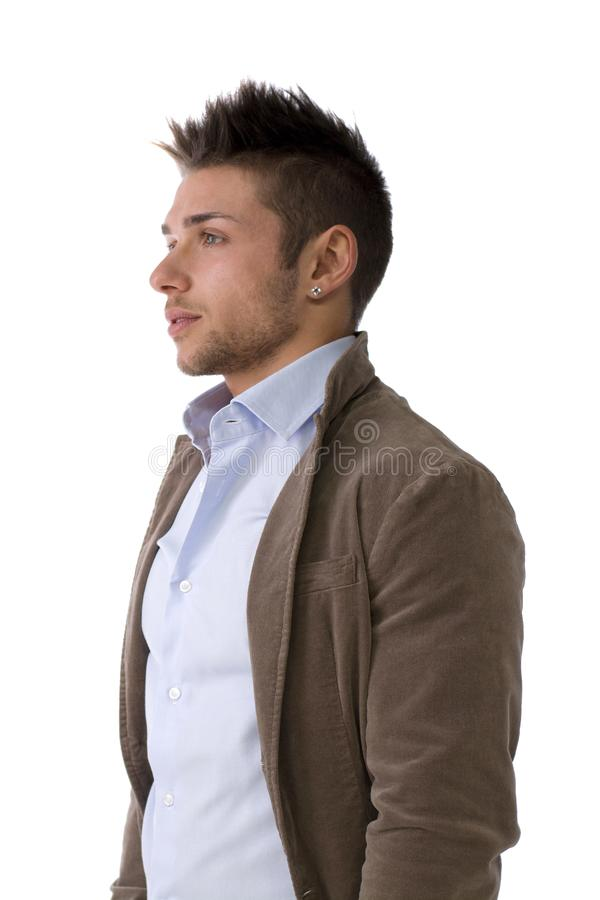 Stilig stående för ung man som står isolerad på vit royaltyfri foto