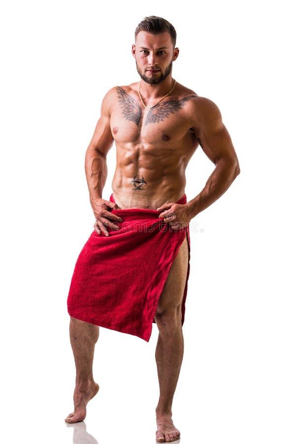 Stilig topless muskulös man med handduken royaltyfri foto