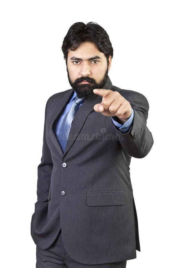 Stilig ung affärsman som pekar fingret royaltyfri foto