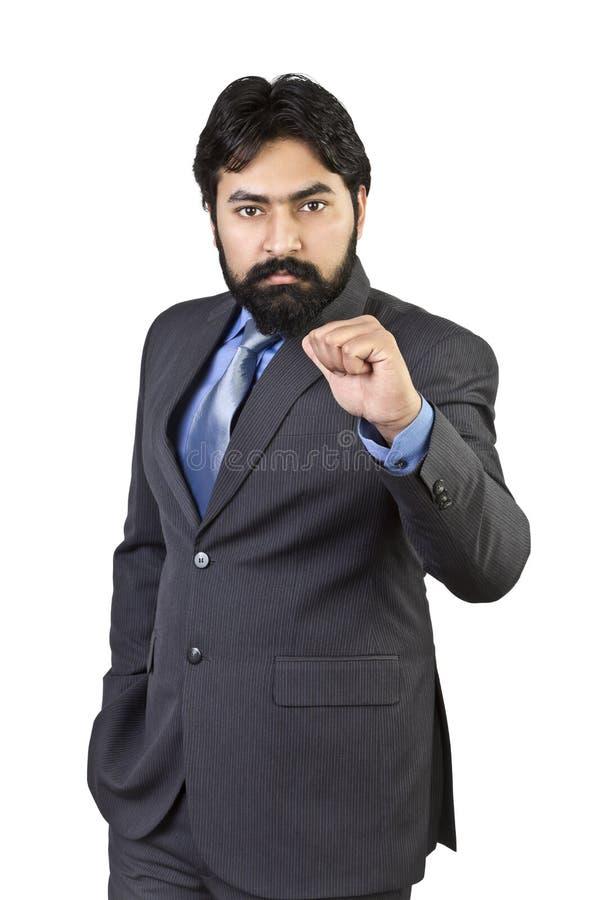 Stilig ung affärsman som pekar fingret fotografering för bildbyråer