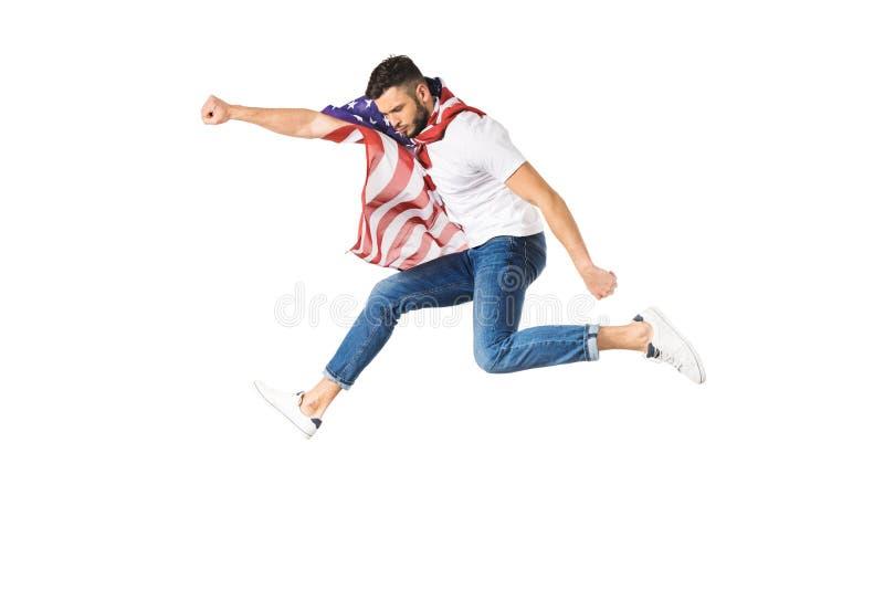 stilig ung man med amerikanska flagganflyg med den lyftta handen royaltyfria bilder