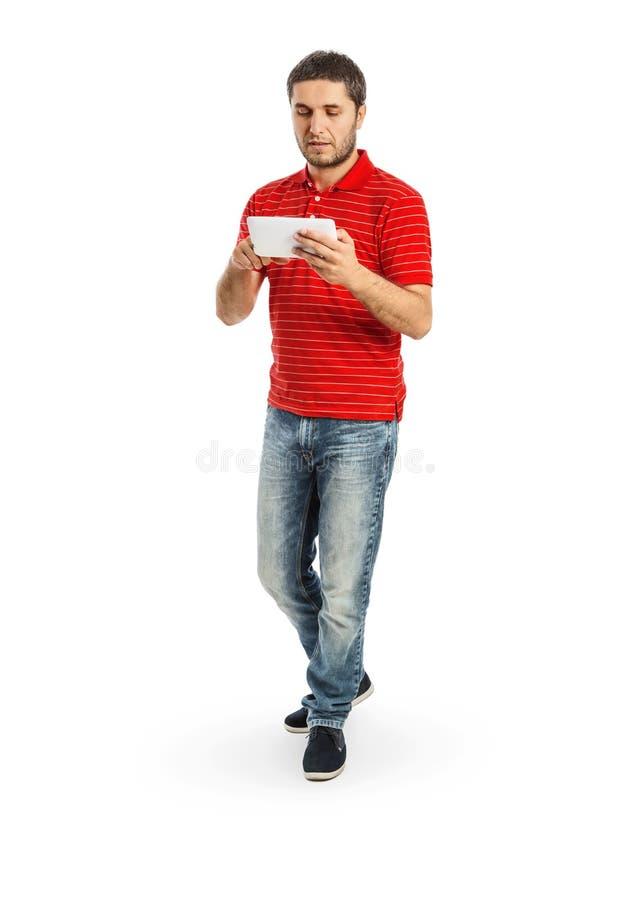 Stilig ung man som använder minnestavlaPC arkivfoton