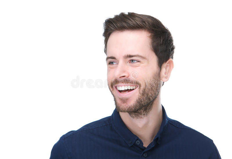 Stilig ung man som ler på isolerad vit bakgrund fotografering för bildbyråer