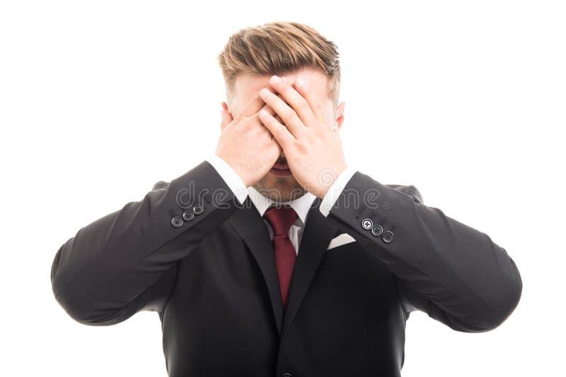 Stiliga ögon för beläggning för affärsman som blind gest arkivfoton