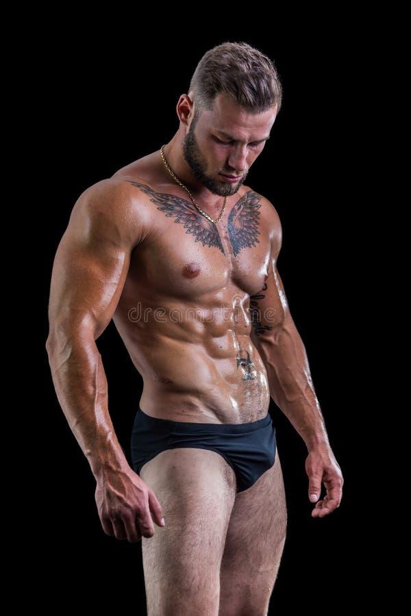 Stiligt topless muskulöst mananseende arkivfoto