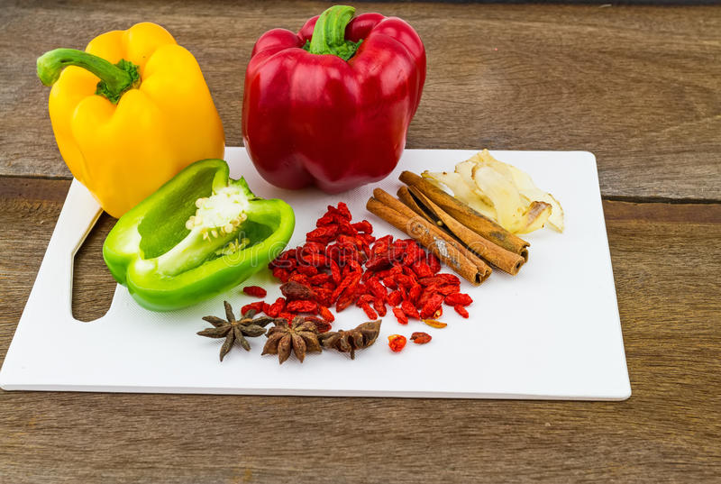Still – life concept sweet bell pepper (capsicum) and assorted spices for China Pharmaceutical Equipment. (goji berries, cinnamon , anise , galangal royalty free stock photo