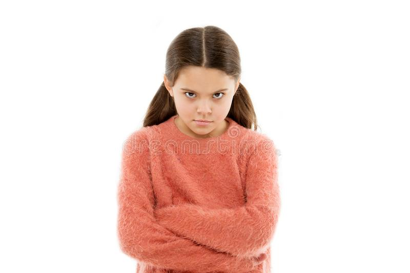 Still angry. Disagreement and stubbornness. Girl serious face offended white background. Kid little girl unhappy looks stock photography