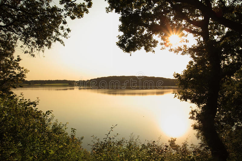 Still Lake At Sunset Stock Photo